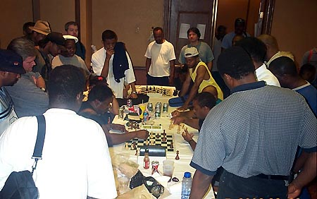 Expert Vester Wilson taking time odds from FM William 'The Exterminator' Morrison in a gladiator chess battle (2003 World Open). Morrison is one of the few U.S. players to reach a high level primarily on the strength of his phenomenal blitz prowess. It also helped that Morrison had a strong 'Black Bear' Club tradition which included players like GM Maurice Ashley and tactical wizard, FM Ronnie Simpson.