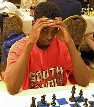 Jacob Wamala is one of the brightest scholastic stars on the horizon. He is the high school co-champion of Massachusetts and has a sister Jessica Wamala who will represent the state at the Polgar tournament for the second year in a row. Photo by Daaim Shabazz.