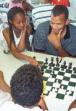 Tate showing his IM title-clinching game with GM Alonso Zapata.