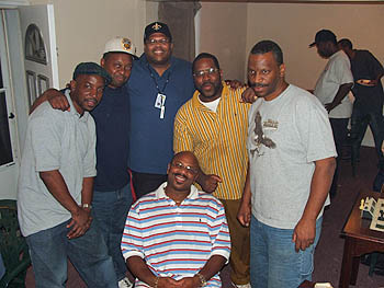 René Phillips (the big guy) with Philly players. Copyright © 2005, Glenn Bady.
