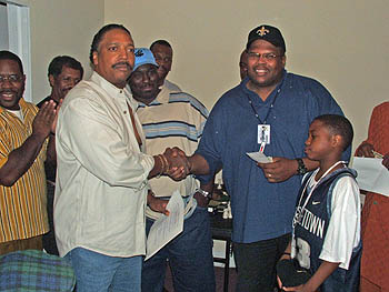Fernwood Jones making presentation to René & son.