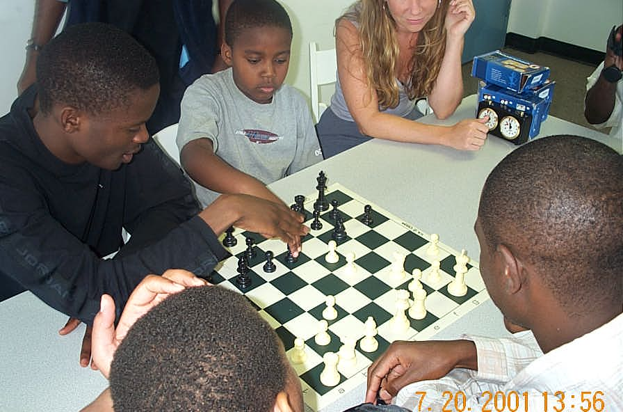 IM Simutowe showing enthused student finer points. Copyright ©, Daaim Shabazz.