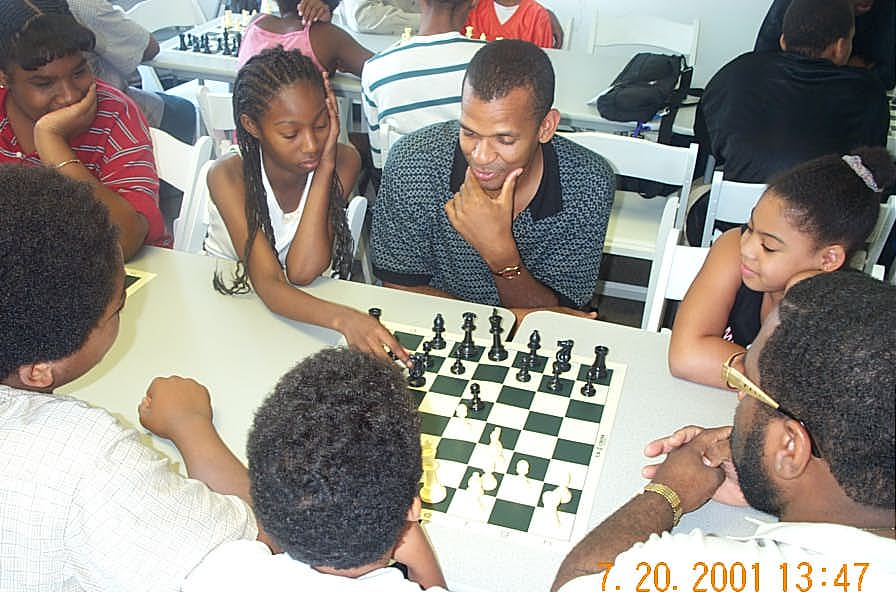 FM Stephen Muhammad watches his student-partner make move. Copyright ©, Daaim Shabazz.