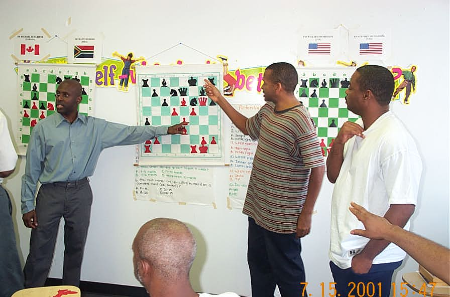 NM Jerald Times and FM Muhammad analyzing Simutowe-Simpson match as FM Morrison looks on. Copyright ©, Daaim Shabazz.