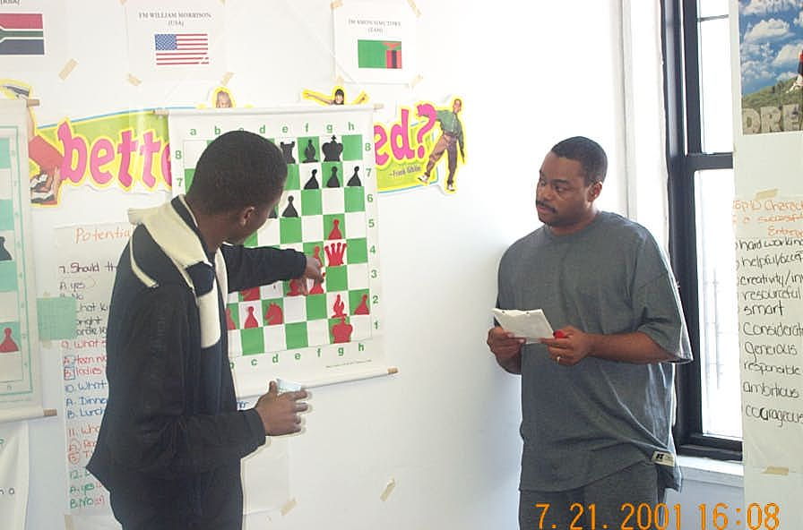 IM Simutowe analyzing with FM Morrison at the 'big board'. Copyright ©, Daaim Shabazz.