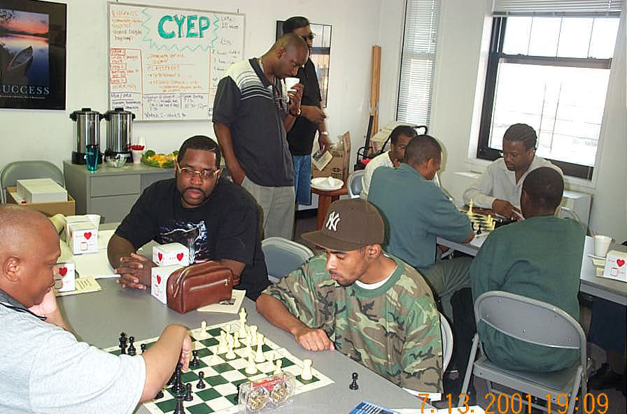 South Africans Kobese and Solomon square off while Muhammad and Ashley lock horns in an intense blitz session. Copyright ©, Daaim Shabazz.