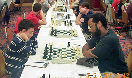Kimani Stancil (right) playing (now GM) Fabiano Caruana at the 2004 World Open (Stancil won). Photo by Daaim Shabazz.