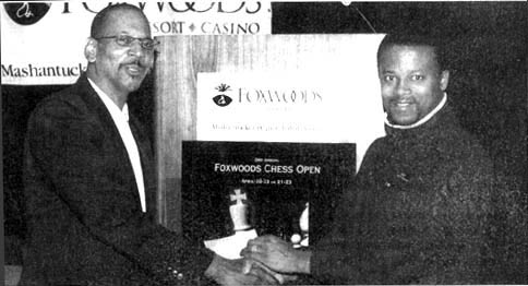 Donald Colbert (left) congratulating  GM Maurice Ashley after his 2000 Foxwoods tournament win. GM Ashley would successfully defend his title in 2001. Copyright © 2000, Jerry Bibuld.
