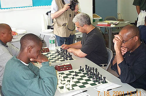 Kobese playing Colding while Nsubuga wrestles Schleifer.