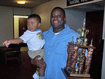 Eddie Mark III (right) celebrating with his son Eddie IV. Photo from buffalochess.blogspot.com.
