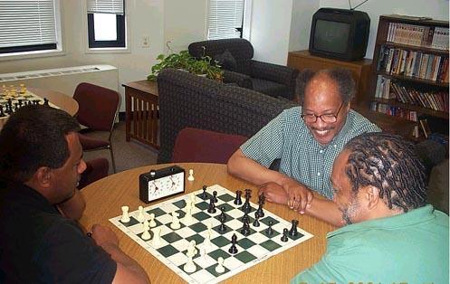Frank Street (center) having a light moment with Willie 'Pop' Johnson (right) while playing blitz with FM Ronald Simpson.