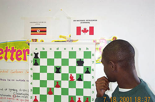 Grace Nsubuga pondering the variation 33.Bd7-f5! Instead he played 33.Bd7-e6?? which immediately lost a pawn to 33...Rae8! 34.d5 Rxd5. FM Ylon Schwartz suggested the move and was standing nearby shaking his head at the missed opportunity. Schwartz is now a big poker star. Wonder if Ylon met
