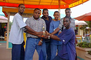 Jamaican Youth Team after beating the Jamaican Senior Team 6½-5½!! (L-R) Equitable Brown, NM Duane Rowe, NM Jomo Pitterson, Alain Morais, O'Neil Myers, and NM Warren Elliott. Copyright © 2001, Jamaican Ambassadors Academy.
