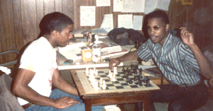 John Porter (R) showing a game to his cousin, Rodney Roberts.