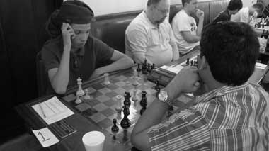 Kassa Korley plays GM Surya Ganguly in the 2010 New York International. Photo by Ron Anderson.
