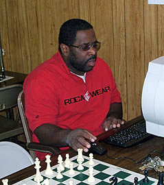 "FM Norman ""Pete"" Rogers playing a league game during the U.S. Chess League. Photo by Glenn Bady."