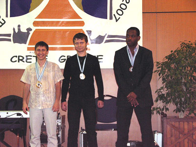 5th board medal winners, Dmitry Jakovenko (Russia - Silver), Alexander Areshchenko (Ukraine - Bronze), Pontus Carlsson (Sweden - Gold) Photo by greekchess.com.