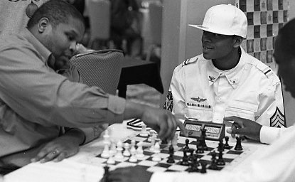 Rene Phillips blitzing with Sulaiman Smith. Photo by Frank Johnson (shootfilm.net).