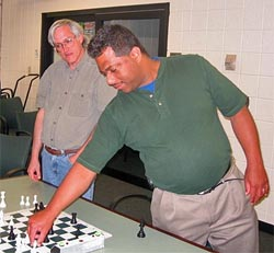 Ronnie Simpson showing Neal Harris (left) a position.
