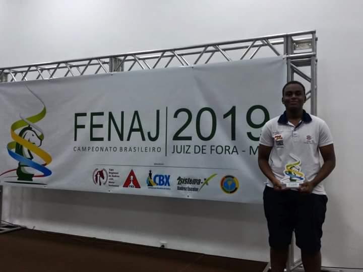 Ryan Caetano with championship trophy at FENAC 2019!