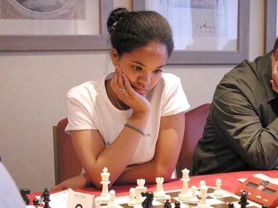 Sabrina Chevannes, of Birmingham, England was 13-years old at the time of this picture and was the 2000 under-13 English champion. He also held the U15 & U16 Girls' titles. She carries a British grade is around 160 (2050 ELO). The above picture was taken at 2001 Birmingham Winter Open and she remains among one of the top female players. Photo by Spectrum Chess.