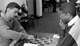 Deon Solomons of South Africa facing IM Maurice Ashley in the 1st Murphy International tournament.. Copyright © 1994, Jerome Bibuld.