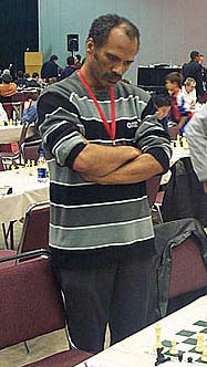 Emory Tate ponders move at Maurice Ashley's HB Global Chess Challenge in 2006. Photo by Daaim Shabazz.