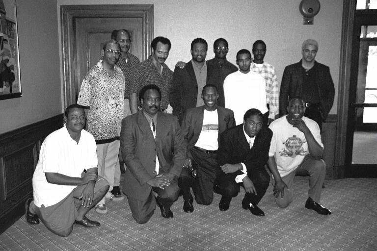 "Kneeling (L-R) FM William Morrison, NM David Allen, Sr., Daaim Shabazz, David Allen, Jr., Sulaiman Smith. Standing (L-R): NM Charles Covington, NM Frank Street, FM Emory Tate, GM Maurice Ashley, Jones Murphy, Jr., FM Kenny Solomon, NM Grace Nsubuga, NM Ernest ""Steve"" Colding; 2001 World Open in Philadelphia. Copyright © 2001, Frank Johnson."