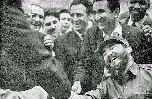 Fidel Castro shaking hands with Bobby Fischer at the 1966 Chess Olympiad in Havana. Tigran Petrosian is behind Castro and was World Champion at the time. An unidentified person of African descent is behind Petrosian. Is that Rogelio Ortega, the 1966 Cuban champion??