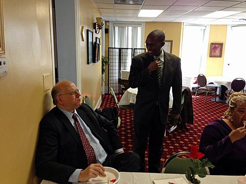 Bill Brock and Daaim Shabazz chatting.