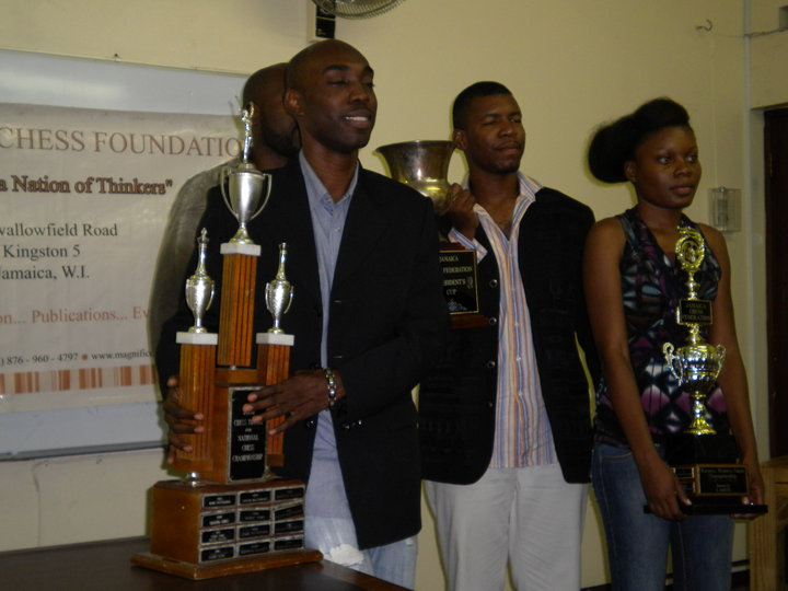 FM Warren Elliott and WFM Deborah Richards receive their trophies. Photo by Peter Myers.
