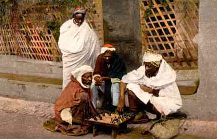"Moors in Algeria playing a form of chess in the 19th century. The original caption read, ""Algers-Negres jouant aux Echecs."