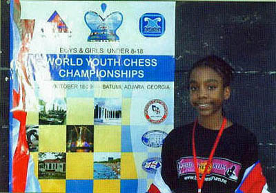 Darrian posing by the tournament advertisement.