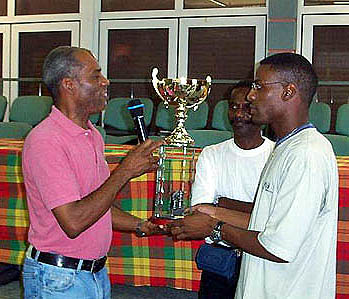 Gilles Suez-Panama receiving his championship trophy at Martinique's 2002 Pavilla Memorial. Photo by Ligue d'Echecs de la Martinique.