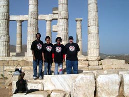 Fritz Gaspard (coach), Luz Parrilla (mother), Medina Parrilla, IM Yury Lapshun (coach) at the Coliseum at Poseidon.
