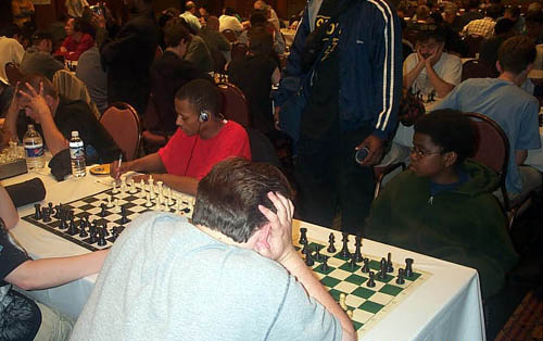 "12-year old Kayin Barclay on ""B"" section's top board at 2003 Chicago Open. Copyright © 2003, Daaim Shabazz"