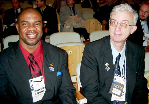 Jamaican Federation President Ian Wilkinson with NM Robert Wheeler at the opening ceremonies at the 2002 Olympiad in Bled, Slovenia. Copyright © 2002, Jerry Bibuld.