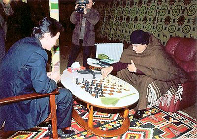 FIDE President Kirsan Ilyumzhinov in a publicity shot with Libyan President Colonel Moammar Al-Qathafi.