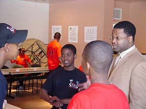 GM Maurice Ashley gives an encouraging word to budding chess players in Oakland, California.