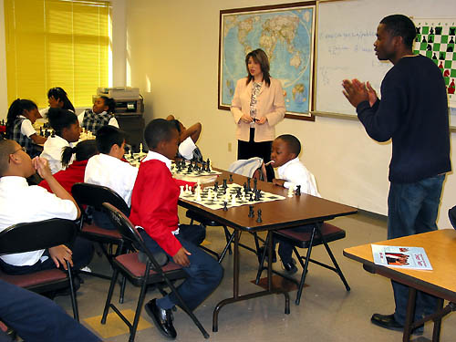 GM Polgar addresses students at St. Phillips School as IM Simutowe encourages his  students.