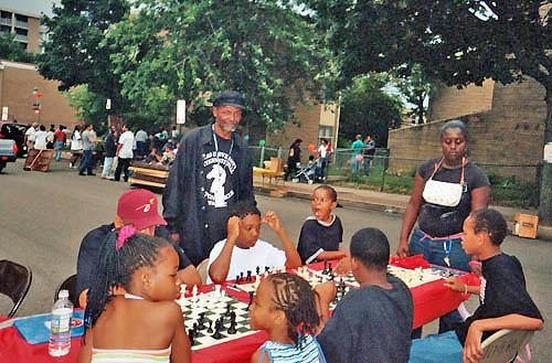 "James Taylor working with young players in the DC area during ""block party"" festivities."
