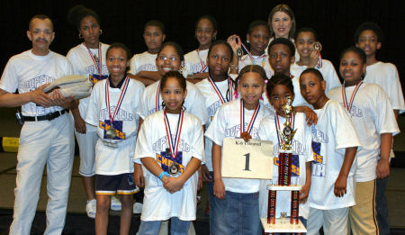 Coach Glenn Smith (left) posing with the Duffield Elementary Chess Team who won 1st place in the unrated section. GM Susan Polgar is standing in the back.
