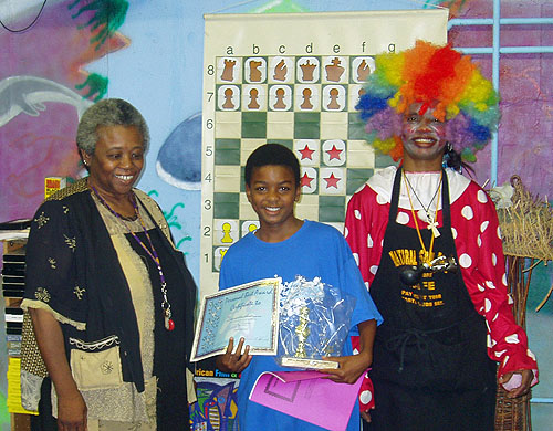 Colette McGruder (left) with prize winner at chess festival.