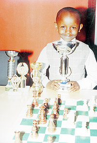 Peniel Weru displays trophies he has won in recent days.