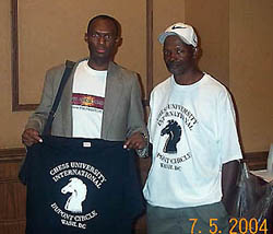 James Taylor (right) present The Chess Drum's Daaim Shabazz with Chess University t-shirt.