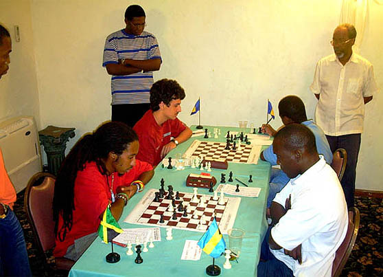 Jamaica's Malaku Lorne in the heat of battle with Bahamas' Charles Duncombe (right) in the final round of the Providence International. Long-time chess organizer Warren Seymour is standing on the right. Photo by Dahalia Smith.