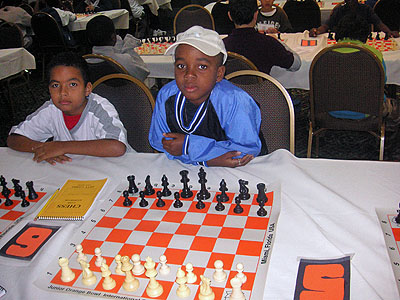 "Joshua Blanchard of Barbados teams with RJ Nelson in a ""bughouse"" tournament. It was RJ's first time playing the variant and enjoyed it tremendously say his aunt, Lesley-ann Nelson."