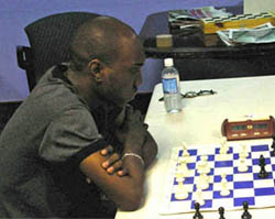 FM Warren Elliott at Cameron Open. Photo by Jamaican ambassadors Chess Academy.