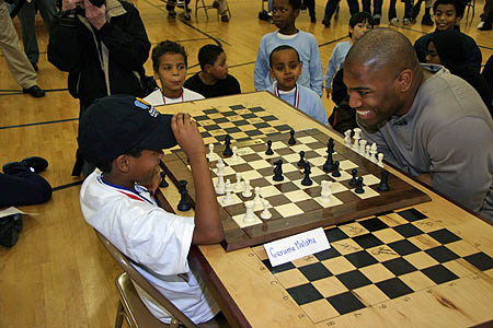 Eight-year old Gerume Malaku (left) joisting a bit with Shaun Alexander of the Seattle Seahawks. Alexander won.