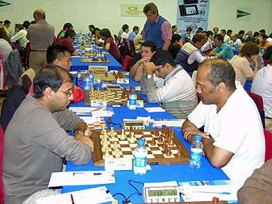 IM Emory Tate (right) takes on Morocco's  GM Hichem Hamdouchi at Calvia Chess Festival. Hamdouchi won in 66 moves. Photo from calviafestival.com.
